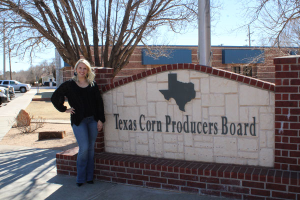 Stephanie in front of the Texas Corn Producer's sign.