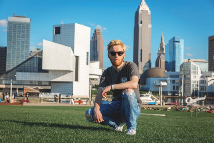 senior picture in front of cleveland skyline