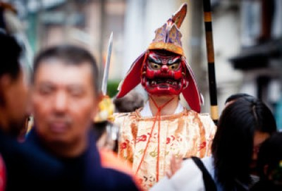 A man wears a Tengu or demon mask during a Japanese fertility festival known as Kanamara Matsuri in Kawasaki, Japan on April 5, 2009. The festival attracts thousands of visitors, mainly foreigners, to see the preformances.