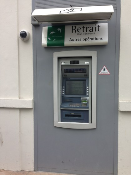 Look for these to pull money. Make sure to ask your bank what ATMs to use before you go abroad though.