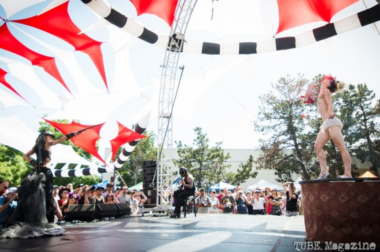 The Vau de Vire Society performing a modern burlesque act which included the popping of balloons wrapped around the performers body until she was left in next to nothing at the 2014 Lagunitas Beer Circus in Petaluma CA. Photo Melissa Uroff