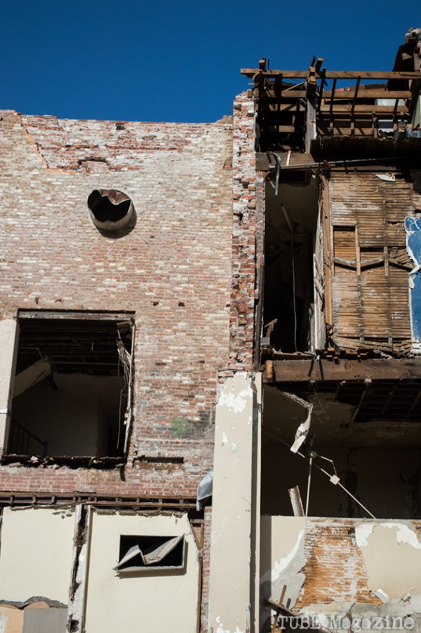 The collapsed side of a partially demolished building along 7th Street. Photo M.Hershenow. 2014.