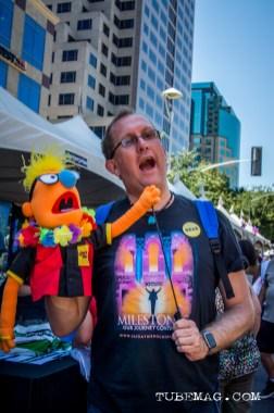 Man poses with a muppet at Sac Pride 2015, Photo Sarah Elliott