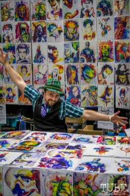 Artist Levi Craig proudly posing in front of his art. Sacramento Wizard World Comic Con 2015. Photo Sarah Elliott
