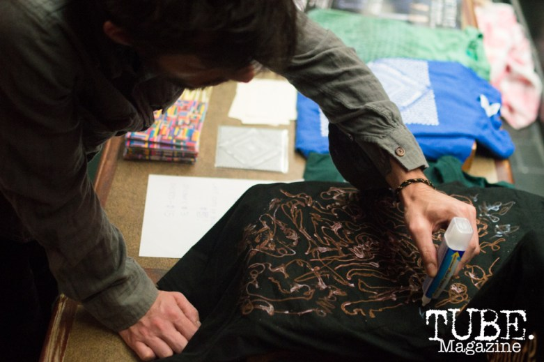 Damian Webb designing a shirt for Separate Spines merchandise at Cafe Colonial in Sacramento, CA. August 2015. Photo Alejandro Montaño