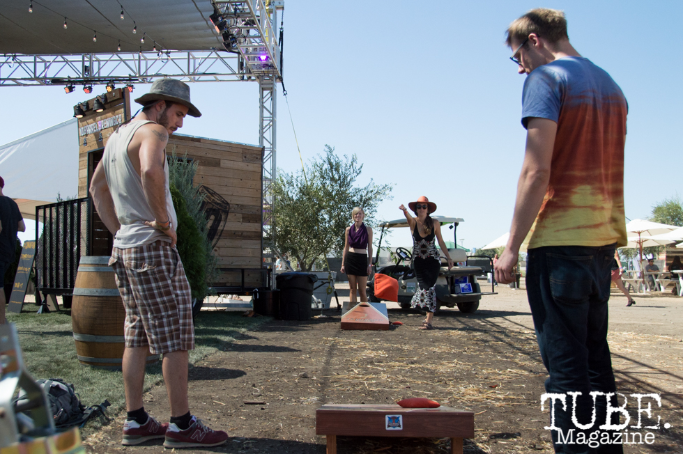 TBD goers playing a game of corn hole during the Demolicious Derby at TBD Festival in Sacramento, Ca. September 2015. Photo Alejandro Montaño