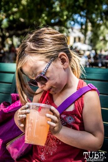 Jackie Elliott blowing bubbles in her strawberry lemonade, Chalk It Up, Sacramento 2015, Photo Sarah Elliott.