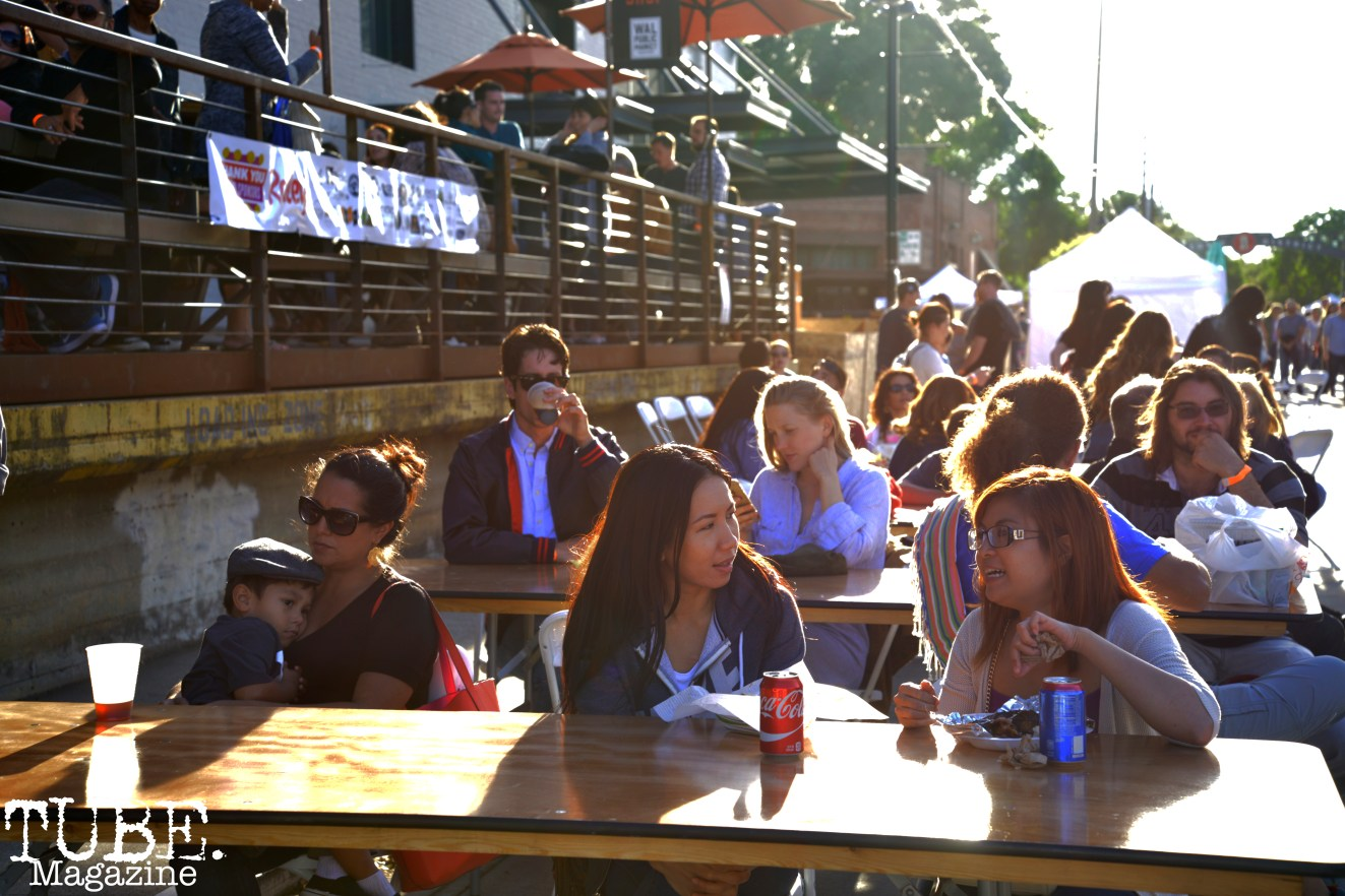 Patrons of the R Street Block Party eat while watching a live music performance in Sacramento, California on Saturday 21, 2016.