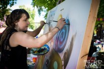 Molly Devlin painting at the Crocker Block by Block Party in District 5, July 9, Sacramento CA. Photo Melissa Uroff