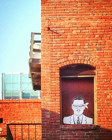"""Doom Sayers."" Unknown Artists, Stencil behind the Crest Theater, 1013 K Street, Sacramento, CA"