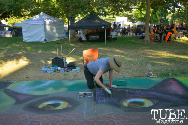 Andrea Johnston creates chalk art at Chalk It Up in Sacramento, CA, September 4, 2016. Photo Emma Montalbano.