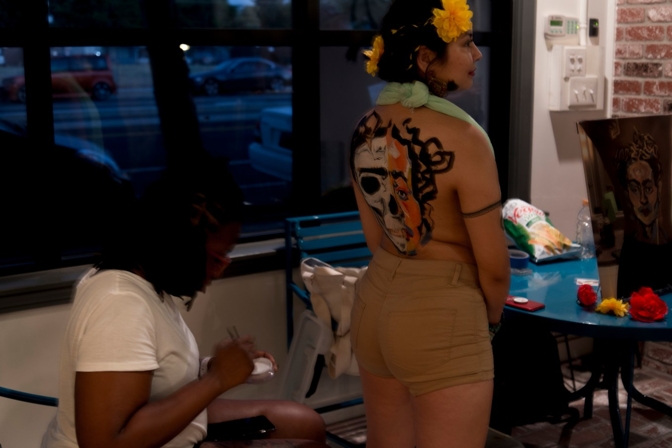 Taneko Chapman body painting at Wounded Deer: A Frida Kahlo inspired art show in Sacramento, CA, July 6, 2018. Photo by Emma Montalbano.