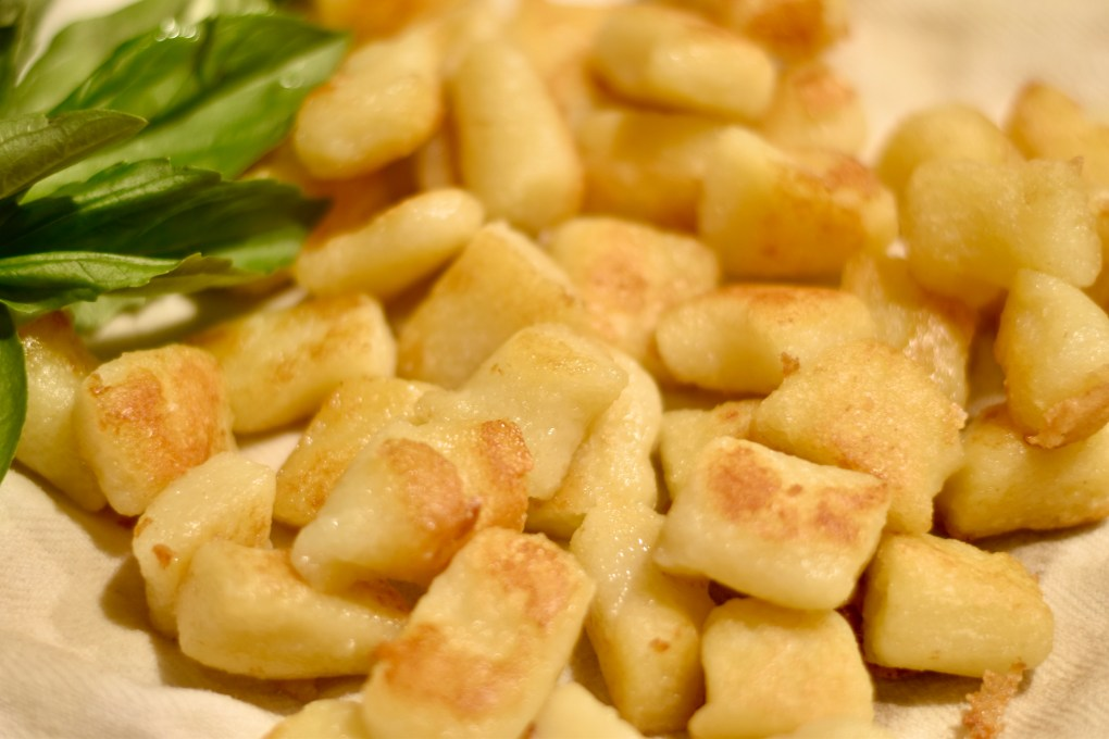 A close up of the gnocchi just out of the hot oil