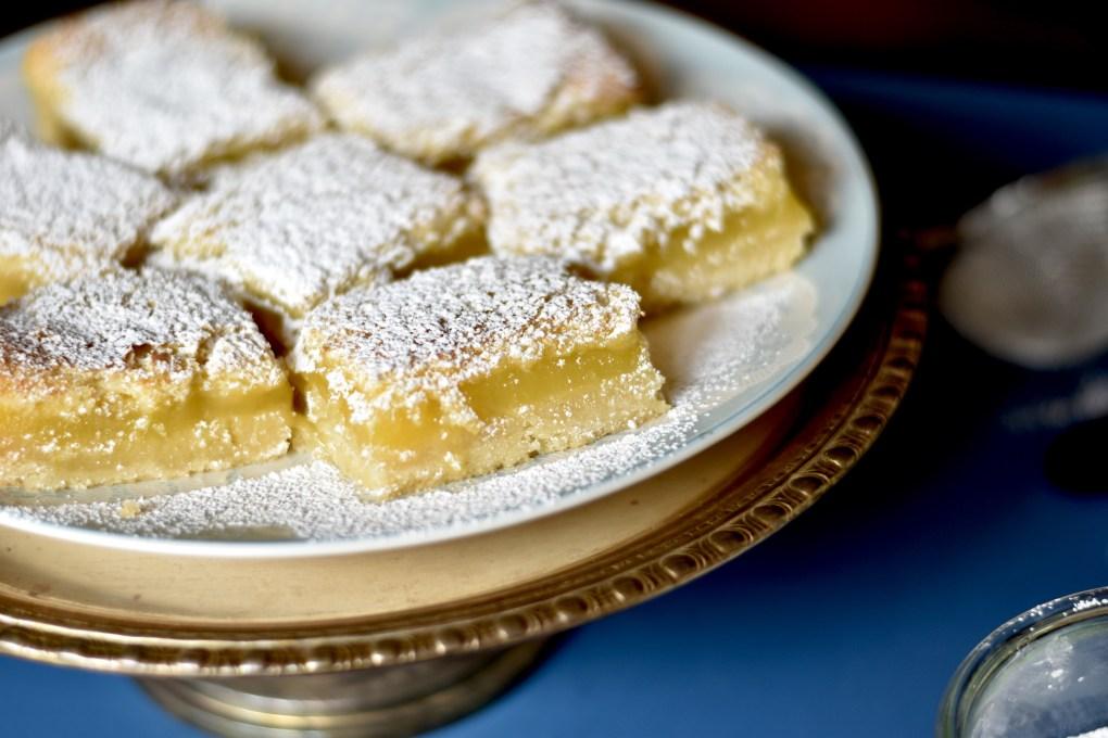 Close up go lemon bars, on a platter of silver