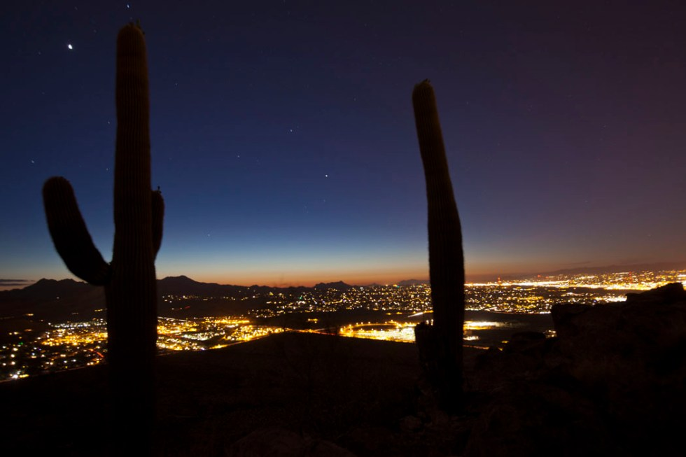 A Tucson sunset viewed from Tumamoc Hill. Light pollution from a developing open-pit copper mine could contaminate the view of the city's night sky.