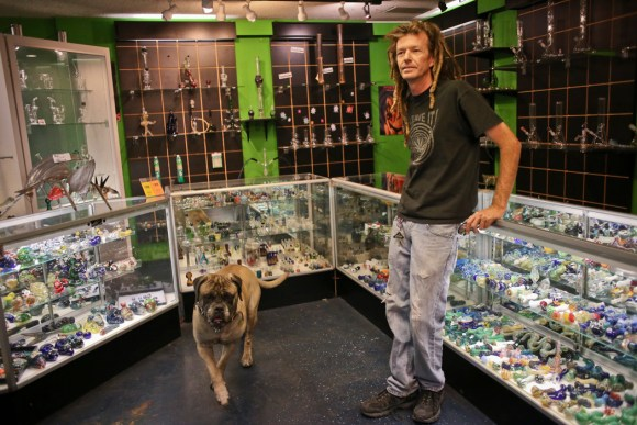 Shane Dalton, 43, owner of Space Smoke Shop in Tucson, sells pipes made only in the United States.