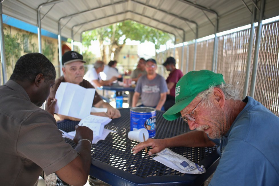 George Littrell, 65-year-old, a Vietnam veteran (right) has been homeless for the past 13 months. Littrell, is currently stationed at Gospel Rescue Mission, May 26, 2015, Tucson, Arizona. Clemon Jacquet, 62-year-old, peer supprt speicalist at Tucson VA (left) was once homeless himself and is helping Littrell to find housing as part of the Tucson Veteran Affairs outreach program.