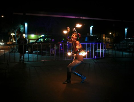 Zoe Rae, 31, performs a fire show using a hula hoop, May 22, 2015, Tucson, Arizona.