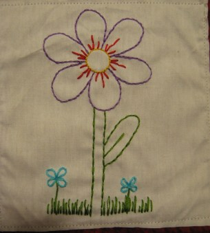 This is the embroidered piece. I had trouble digging up an embroidery frame small enough for it, I usually work with big stuff.