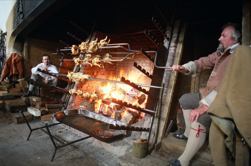 multi-armed spit being used to roast chickens