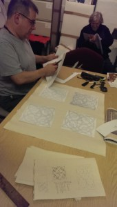 Jorge starts roughig out the design for the sugar garden using photocopies and sketches