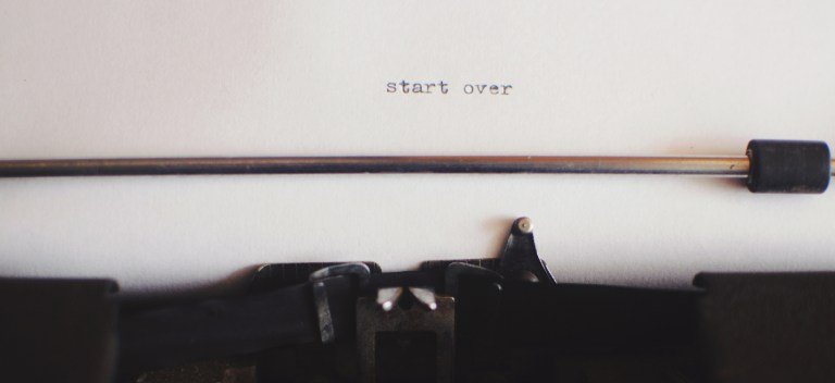 "Vintage typewriter types the words ""start over"""