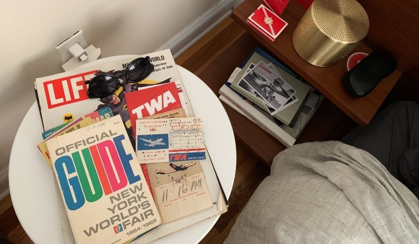 a closeup of the nightstand with vintage TWA items