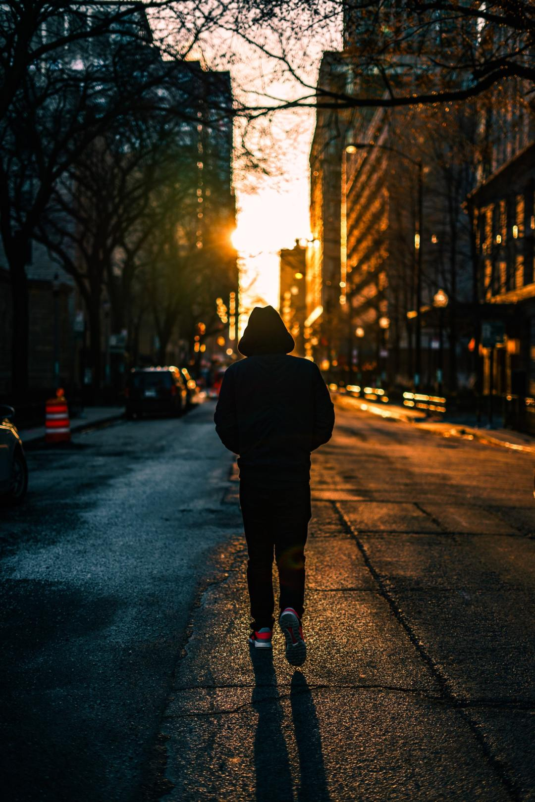 person walking on the road
