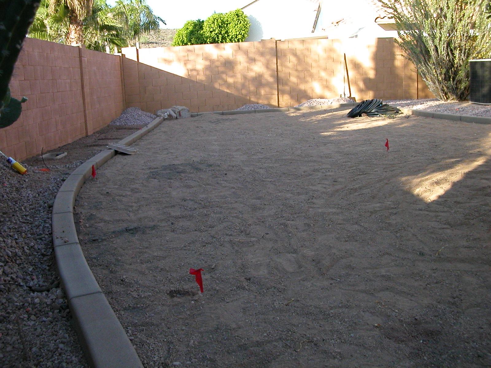 Curbing & yard prepped for sod