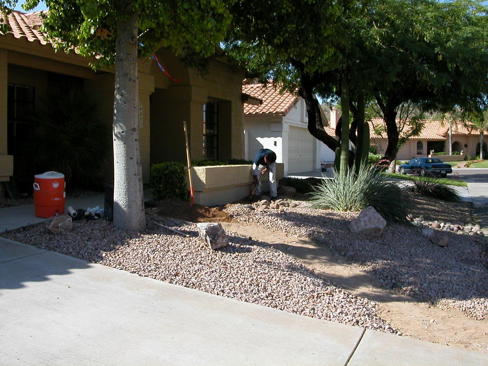 Digging sprinkler lines, front