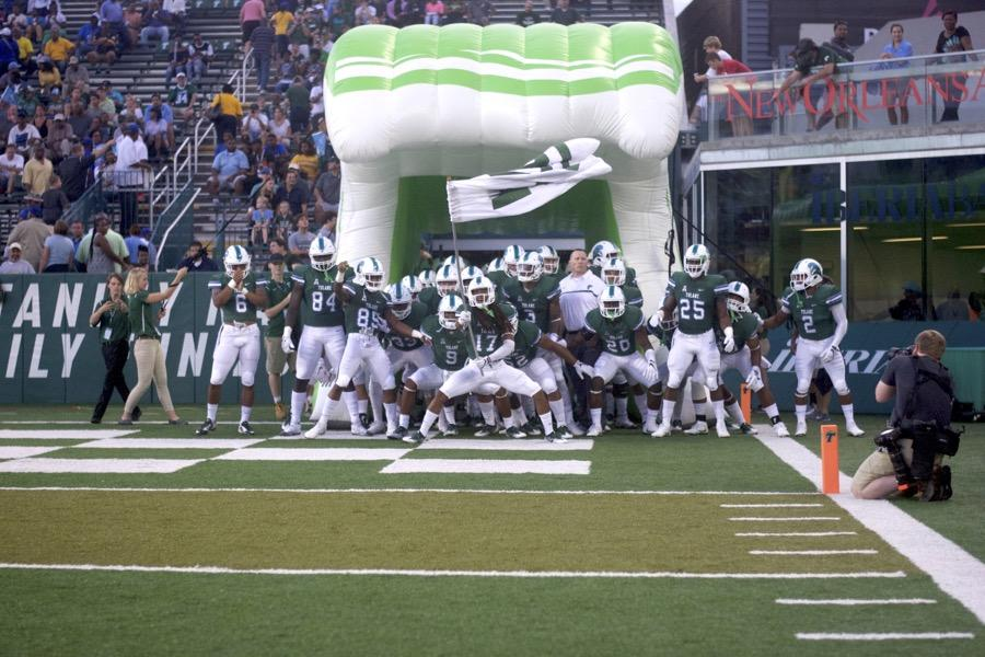 Tulane+football+charges+onto+the+field+against+Southern+University+on+Sep.+10.+