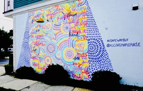The 'Purple Purse' mural was painted with permission of the Yes Yoga studio at the corner of Oak and Cambronne Streets .jpeg