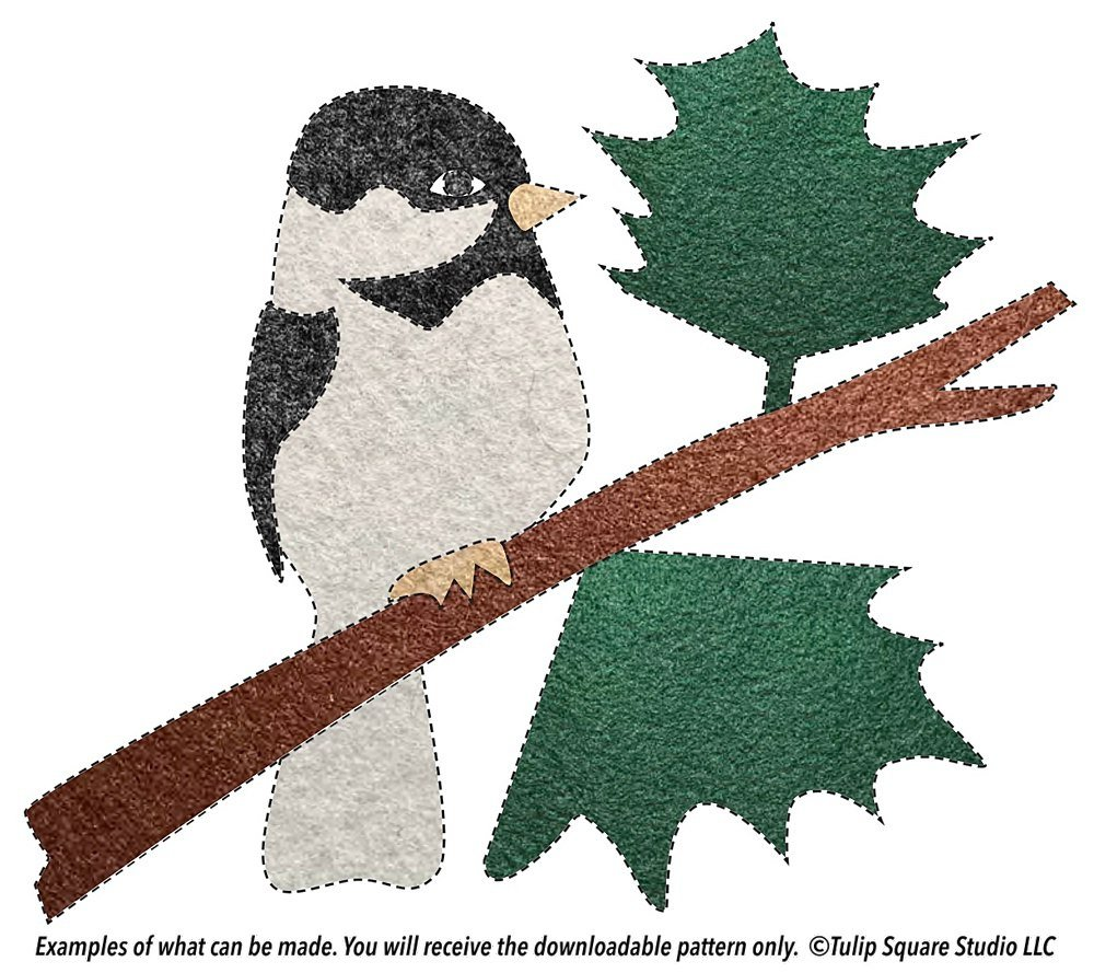 Black and white bird, branch, and leaves, made of felt appliqué.