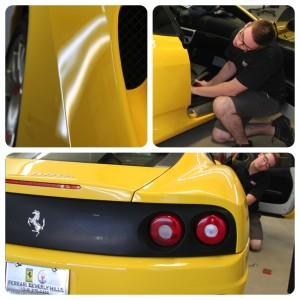 Exotic car specialist Derek works on a Ferrari Modena