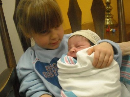 Siblings - my oldest holding my youngest when she was born