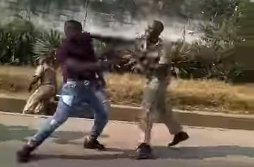 CRAZY:  Civilian,  Traffic Police Officers Exchange Blows