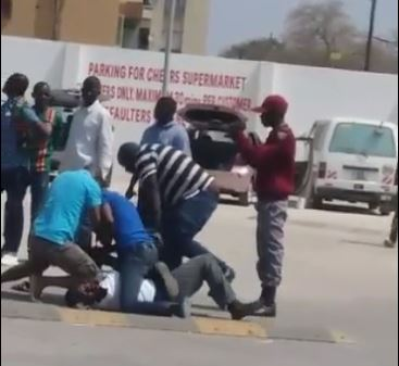 Security Badly Beaten For Clamping A Vehicle of People Claiming To Be From Security Wings
