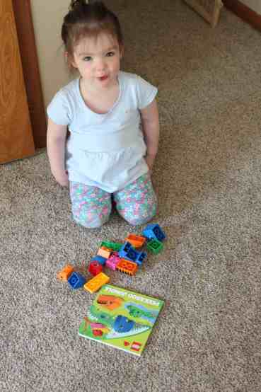 These read and build lego books are so fun for toddlers! A cheap activity to develop toddlers' spatial skills and teach them how to follow lego directions.a