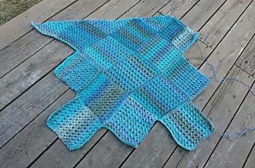 This is a baby blanket. I am doing the corners a little differently on the last round.