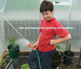 Cute and having fun growing his tomatoes