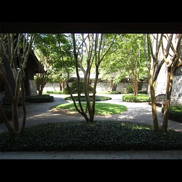 View of courtyard from walkway at Northwest Presbyterian Church in Buckhead in Atlanta, Georgia, designed by Tunnell and Tunnell Landscape Architecture.