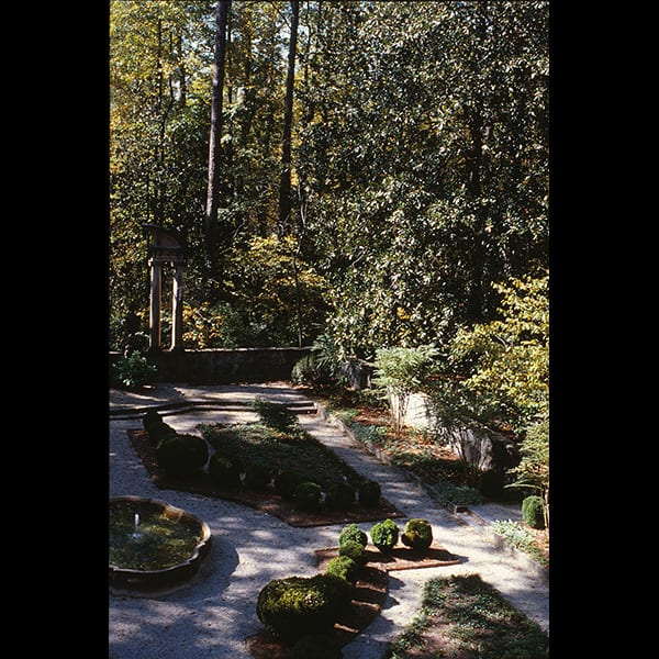 View of boxwoods and path in the Boxwood Garden at the Swan House in Atlanta, Georgia, historic restoration by Tunnell and Tunnell Landscape Architecture.