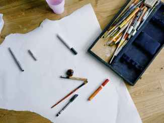 set of painting tools scattered on floor