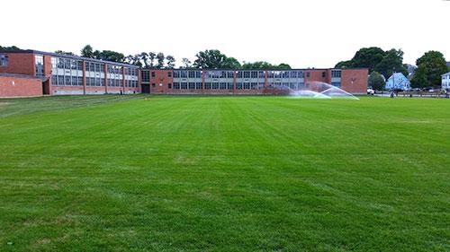 sod installation portfolio image of school soccer field in Quincy MA