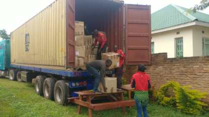 Truck is unloaded in Malawi with Turing Trust donations.