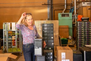 Dr Sally Smith drops off PCdonationfrom Edinburgh Napier University