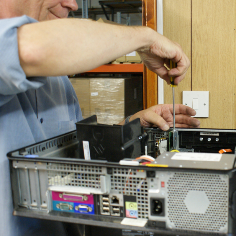 Volunteer refurbishes a computer