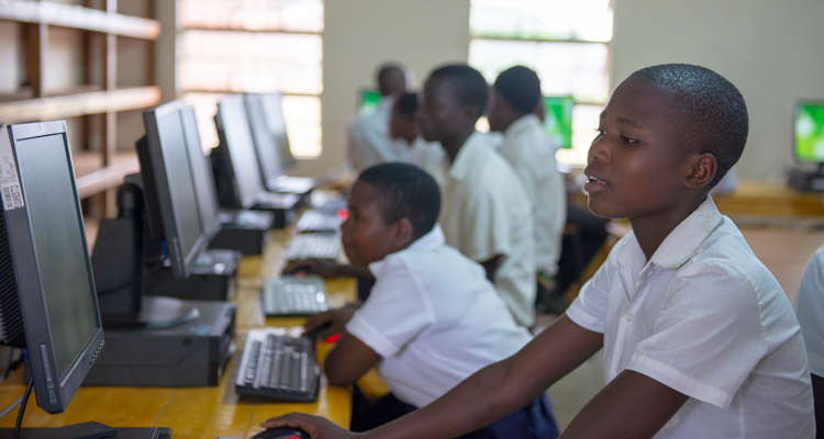 Student using computer lab at Nyungwe Community Day Secondary School