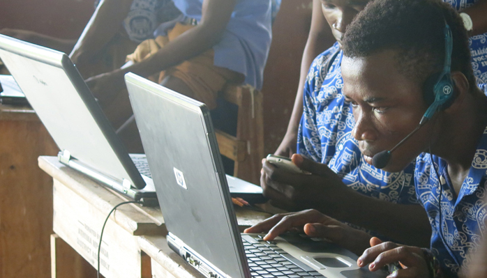 Students using laptops at Otaakrom ICCES, Ghana