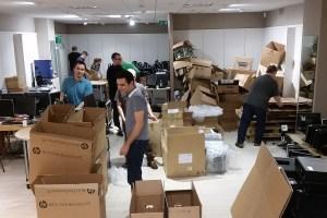Skyscanner volunteering day packing monitors